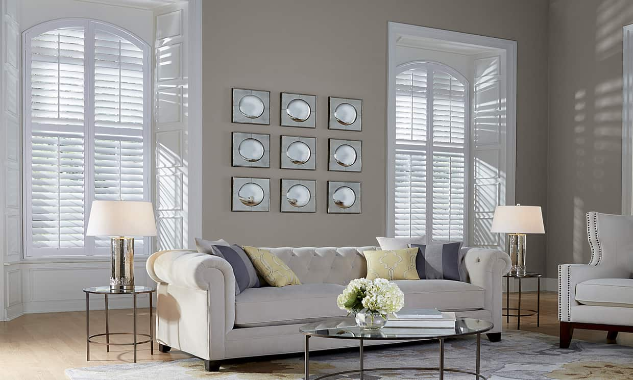 living room with white plantation shutters on windows